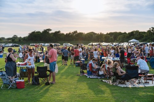 People gathered on the polo field for a concert